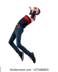 Side view of man in zero gravity or a fall. guy is flying, falling or floating in the air.  A man in a striped sweater is balancing on the tips of his toes, strongly leaning back.