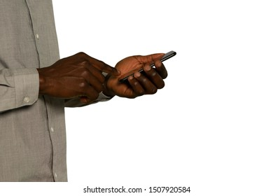 Side view mid section of a young African American man using a smartphone