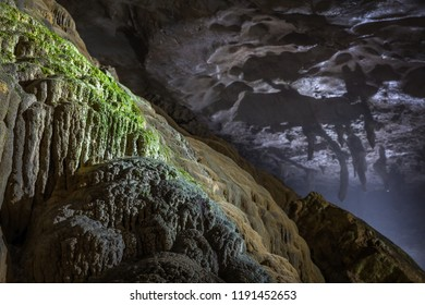 Side view of the mineral formation Mt. Fuji (Donai Fuji) inside Akiyoshi Cave, Japan's largest limestone cave, with stalactities in the background