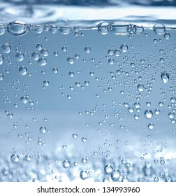 Side view of mineral water bubbles and surface