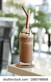 Side view of Moccha frappe topping with whiped cream and chocolate sauce.