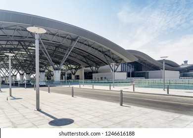 Side view of Muscat International Airport in Oman. Terminal 1 on blue sky background.