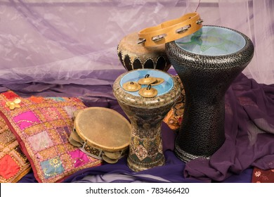 Side view of musical instruments of a bellydance percussion group with darbuka's, tambourines and zills