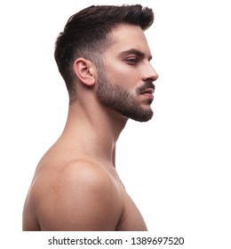 side view of a naked man looking away superior on white background
