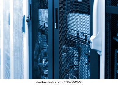 Side view network server room with racks in big data center. Datacentre interface and equipment.
