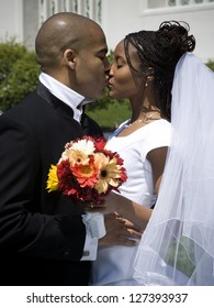 Side view of a newlywed couple kissing