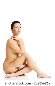 Side view of nude caucasian female sitting.
