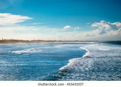 Side view of ocean waves. Fantastic seascape with waves moving to shore in Bali, Indonesia. Sea waves moving to beach. Outdoor travel to Bali, Indonesia travel concept photography