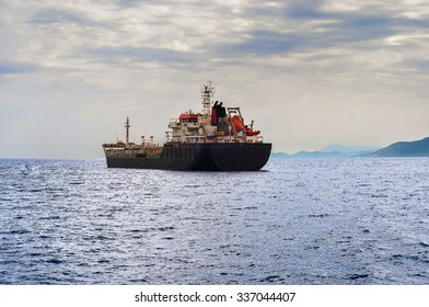 Side view of oil or petroleum tanker ship exporting fuel and sailing in the sea