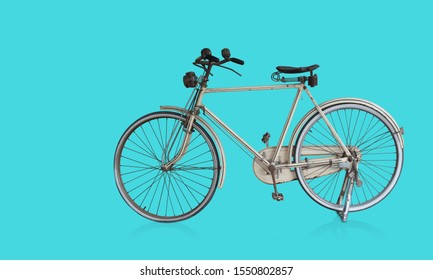 Side view old white bicycle on blue background,transportation,object, copy space