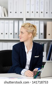 Side view on blond and beautiful young businesswoman at work