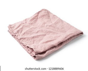 Side view on folded old rose color linen napkin isolated on white background. obscure pink linen napkin. Isolated on white with clipping path.