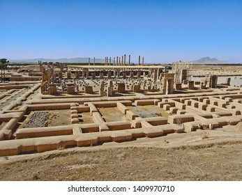 Side view on ruins of Palace of 100 Columns in Persepolis, ancient capital of Persian Empire. Columns on background is Apadana, heart of complex. Persepolis located near Shiraz, Iran