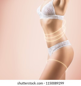 Side view on woman's slim body in lace lingerie. Over beige background.