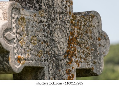 Side view of orthodox tombstone, gravestone cross with detailed religious stone carvings - landscape