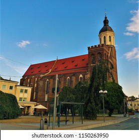 Side view of the Our Lady of the Assumption Co-Cathedral (Konkatedrala Nanebevzeti Panny Marie), a majestic Catholic church found in the historic center of Opava, Silesia, Czech Republic