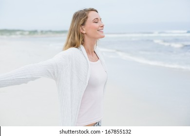 Side view of a peaceful casual young woman with eyes closed at the beach