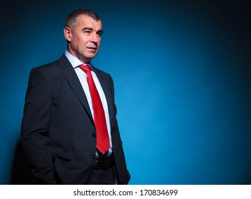 side view of a pensive mature business man looking away from the camera