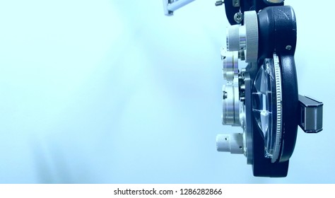 Side view of phoropter with blue background