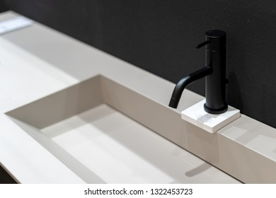 Side view photo of black mixer cold hot water in modern faucet bathroom over white sink