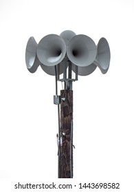 A side view photograph of a several multi directional round electronically amplified emergency siren or noon time horns or speakers on top of a wooden pole in a small town in Wisconsin.