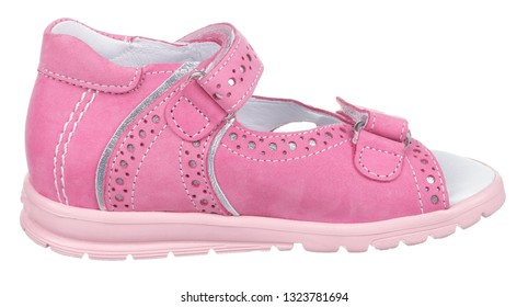 Side view of pink and white suede girl sandal with perforation, slits and slots, and two velcros, isolated on white