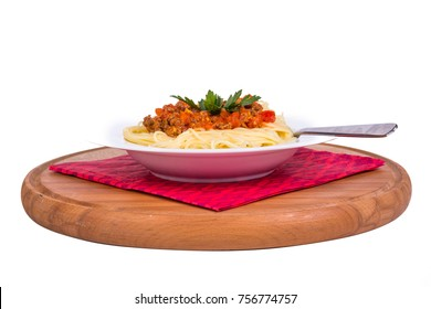 Side view of plate of spaghetti pasta with tomato bolognese sauce, isolated on white background.