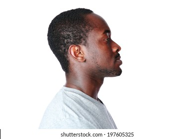 Side view portrait of african man over white background