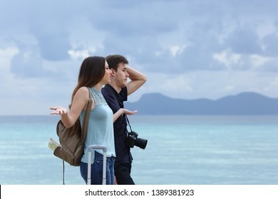 Side view portrait of an angry couple complaining on a cloudy vacation