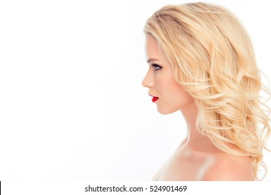 Side view portrait of beautiful blonde with modern hairstyle