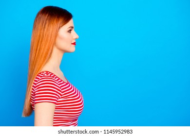 Side view portrait of beautiful smiling woman in casual clothes isolated on shine vivid blue background with copy space for text