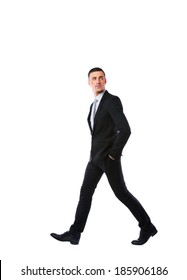 Side view portrait of a businessman walking isolated on a white background