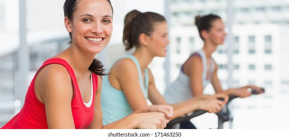 Side view portrait of fit young people working out at class in gym