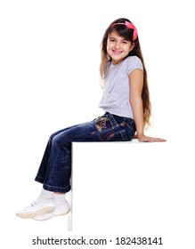side view portrait  of girl sitting on white