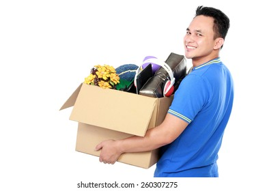 side view portrait of handsome young man carrying box full of stuff on white background