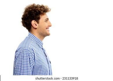 Side view portrait of a happy man isolated on a white background