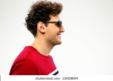 Side view portrait of a happy man in sunglasses
