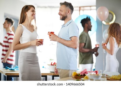 Side view portrait of joyful guests mingling during indoor party, copy space
