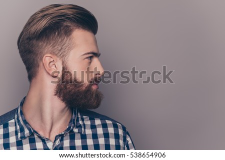 Side view portrait of thinking stylish young man looking away