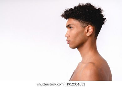 Side view portrait of a young handsome mixed-race man without clothes isolated over white background