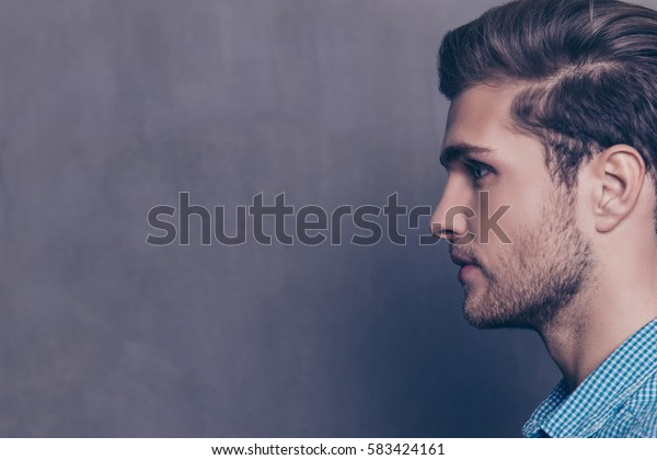 Side view portrait of young handsome confident  guy
