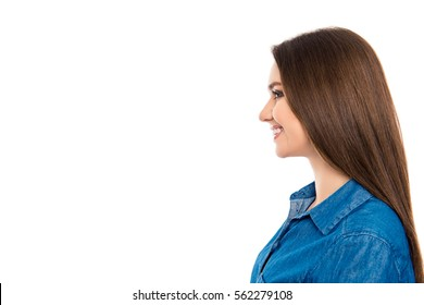 Side view portrait of young pretty smiling woman