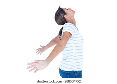 Side view of pretty brunette with arms outstretched on white background