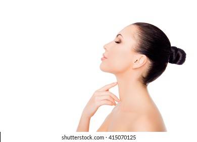 Side view of pretty woman touching her neck on white background