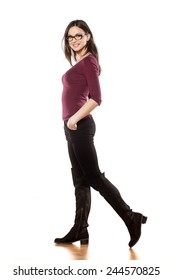 side view of pretty young woman, walking on white background