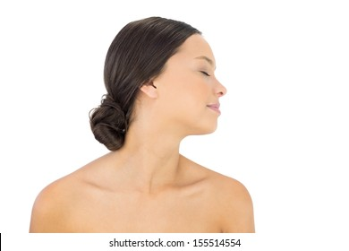 Side view of relaxed brunette on white background