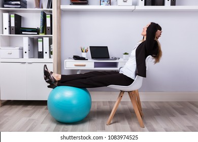 Side View Of A Relaxed Businesswoman Stretching Her Arms
