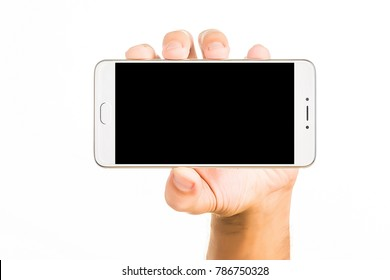 Side view of relaxed left hand of young human male hold beautiful modern blank screen smartphone in a palm isolated on abstract blurred white background. Detailed closeup studio shot