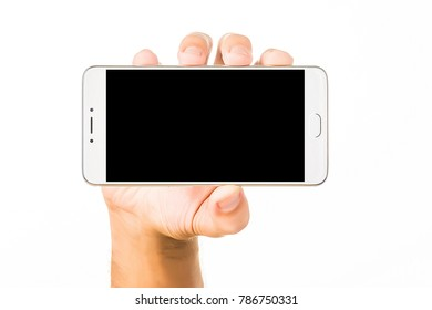 Side view of relaxed right hand of young human male hold beautiful modern blank screen smartphone in a palm isolated on abstract blurred white background. Detailed closeup studio shot