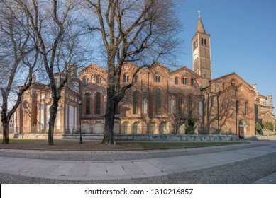 side view of Romanesque saint Eustorgio church in city center, shot in bright winter light at Milan, Lombardy,  Italy